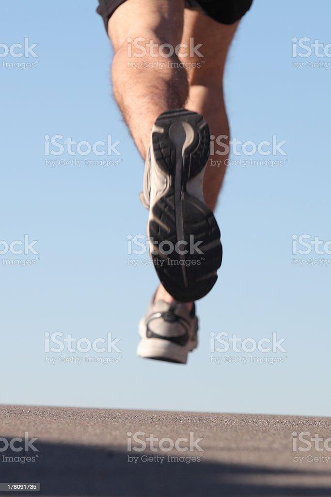 Unfocused sportsman legs running on the asphalt stock photo