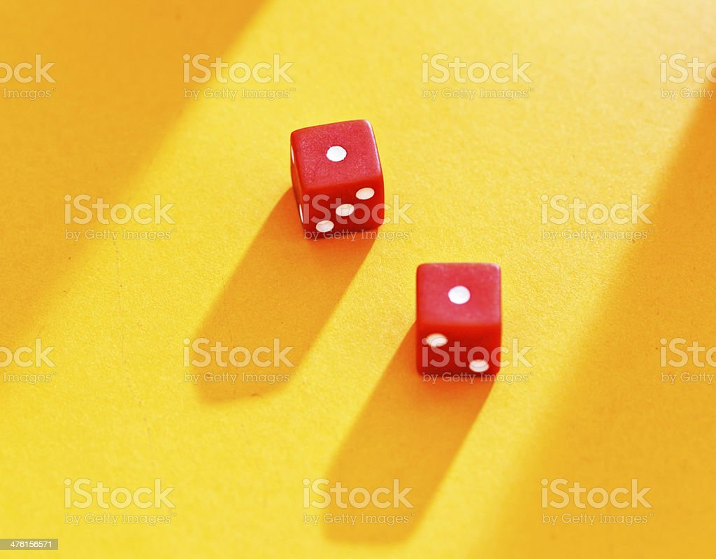 Unfortunate throw of 2 for red dice on yellow background royalty-free stock photo