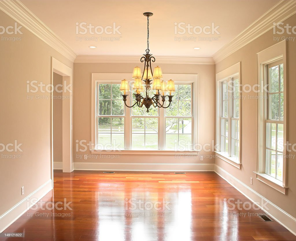 unfurnished diningroom with lots of windows stock photo