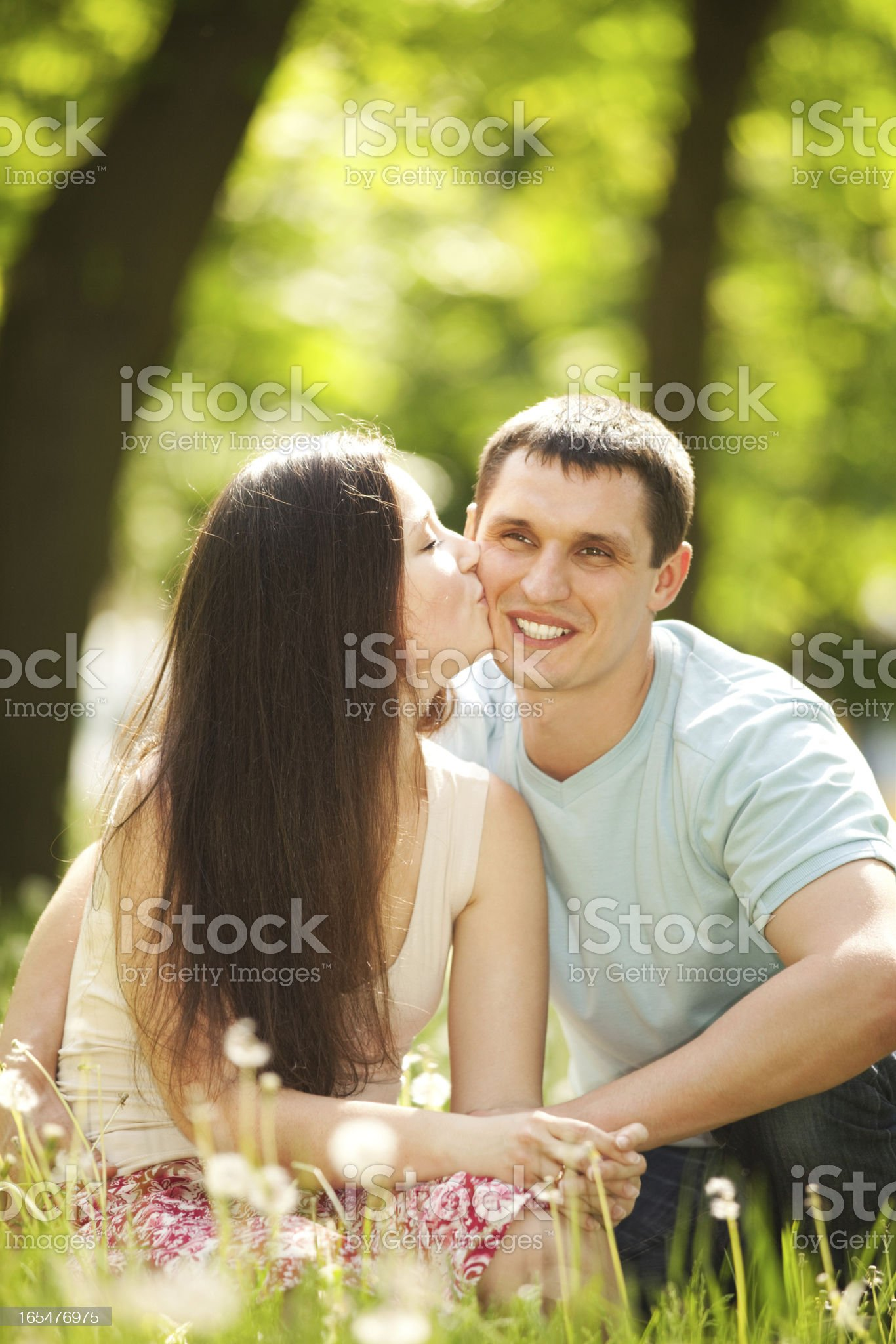 ung happy couple kissing in the park royalty-free stock photo