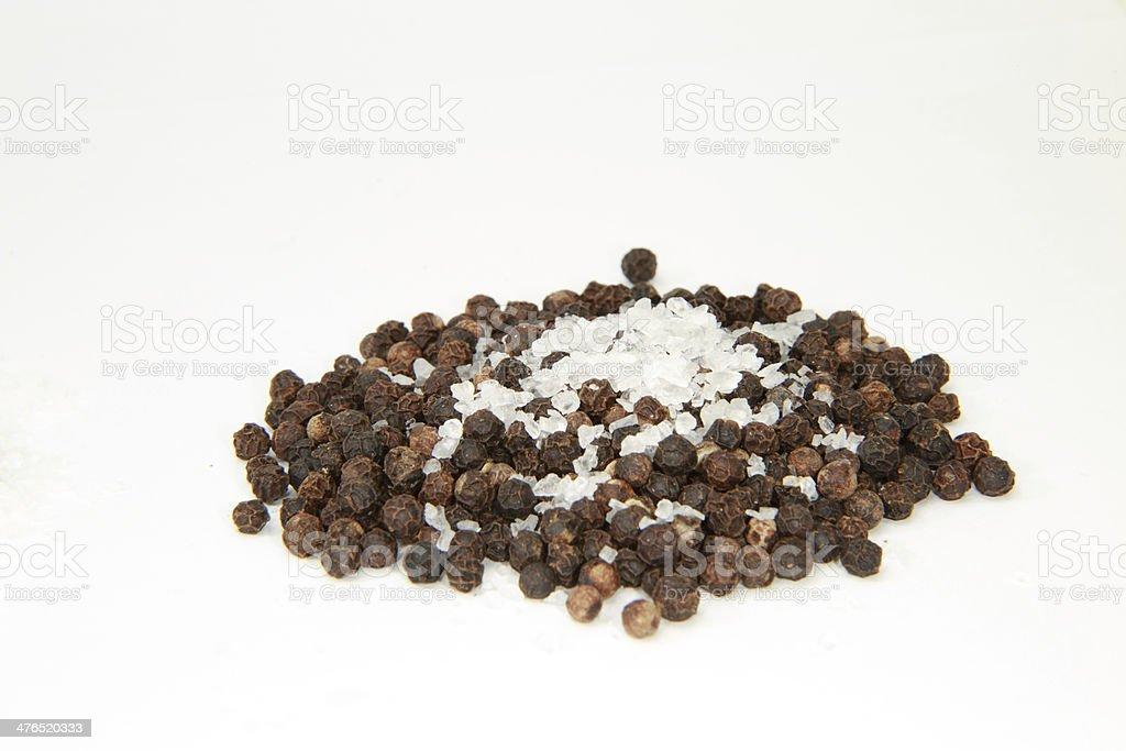 Unground Peppercorns With Sea Salt royalty-free stock photo