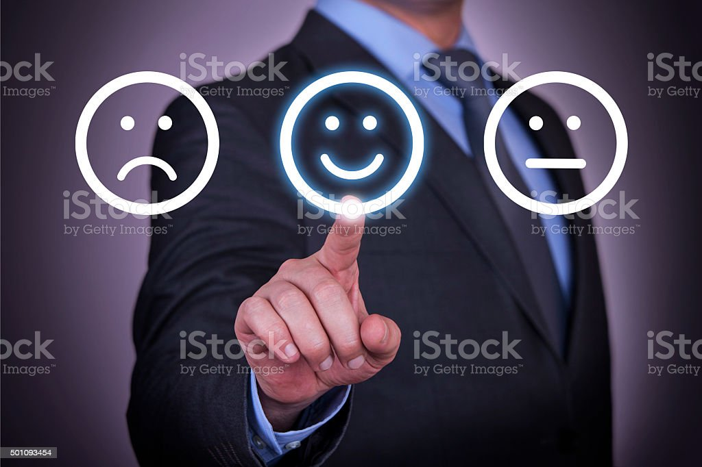 Unhappy and Happy Smileys on Screen stock photo