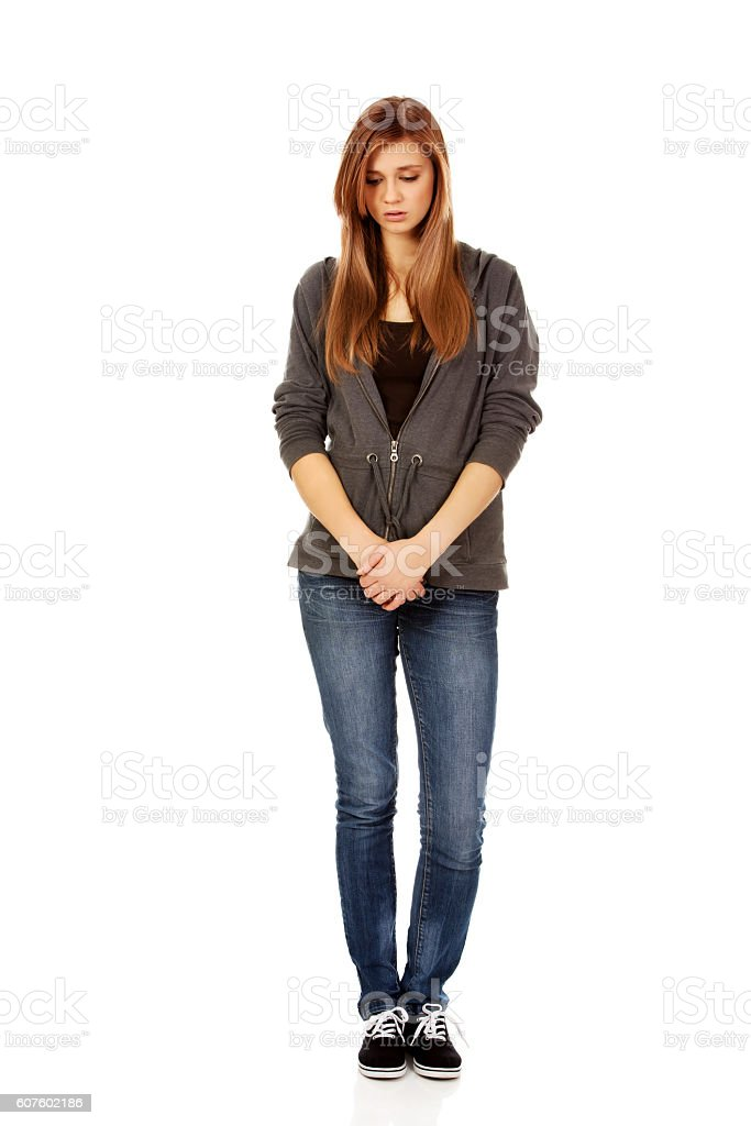 Unhappy and thoughtful teenage woman stock photo
