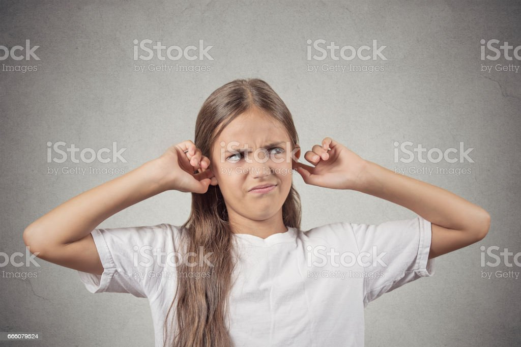 unhappy angry teenager girl giving signs with arms stock photo
