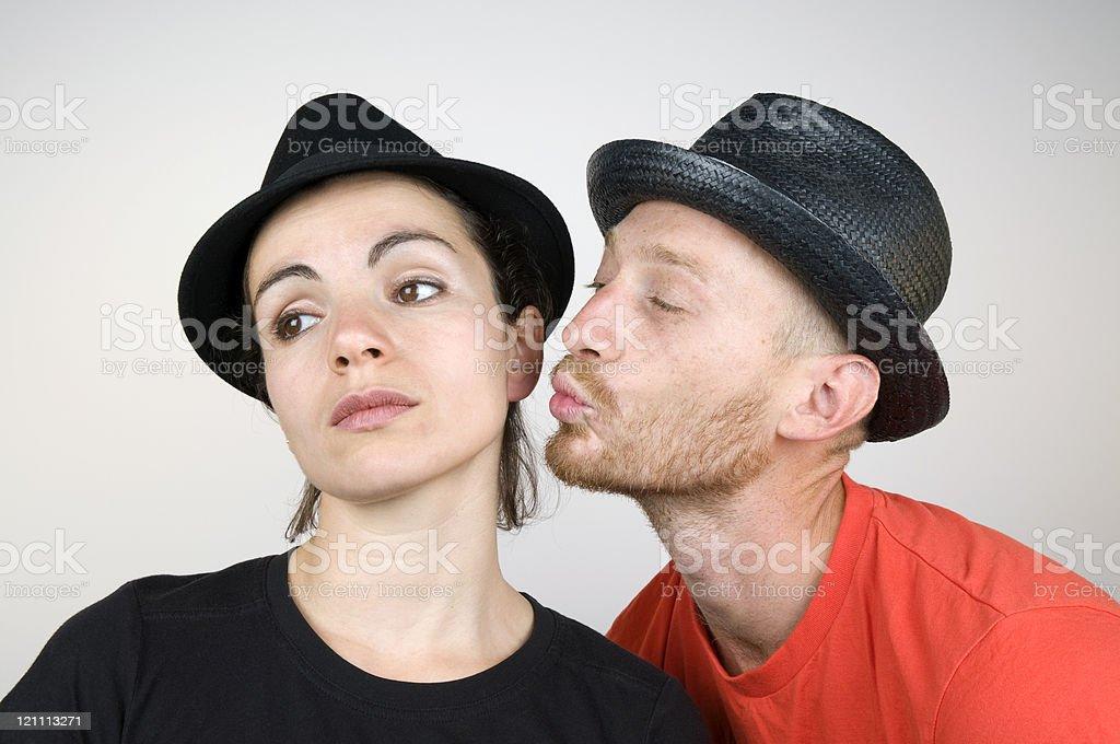 Unhappy Atractive Woman Receiving Kiss royalty-free stock photo