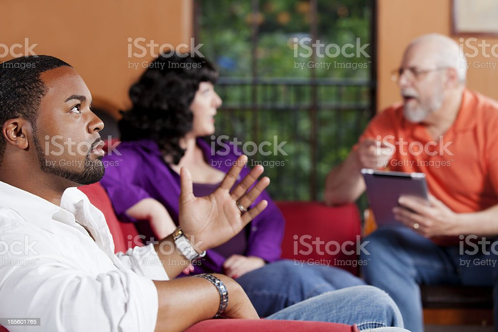 Unhappy biracial couple at a marriage counselor royalty-free stock photo