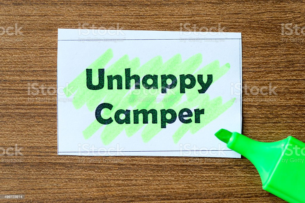 unhappy camper word hightlighted stock photo