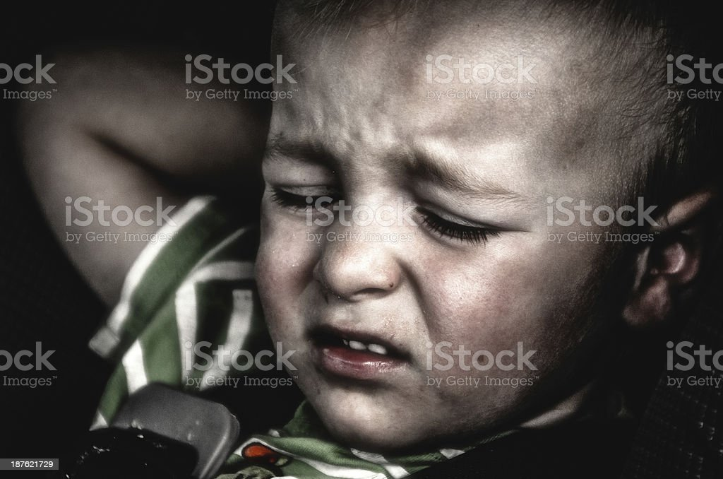 Unhappy Child in a Car Seat stock photo