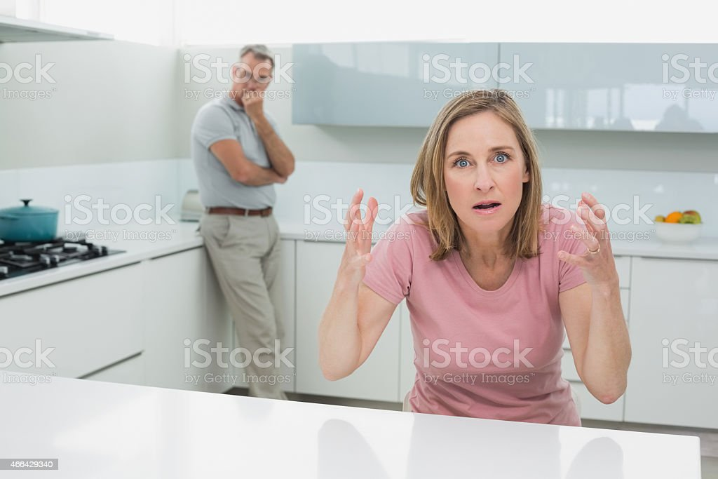 Unhappy couple not talking after an argument in kitchen stock photo