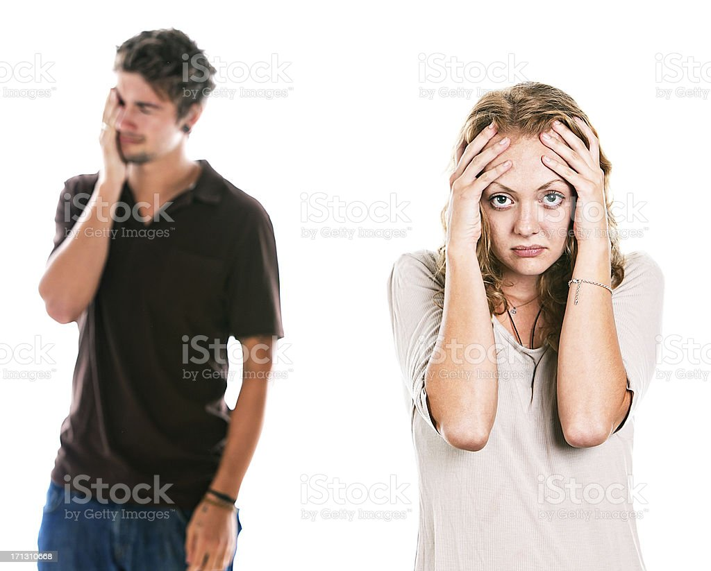 Unhappy couple with hands to their heads look depressed stock photo