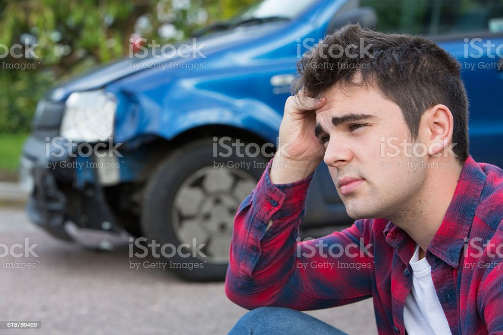 Unhappy Driver With Damaged Car After Accident stock photo