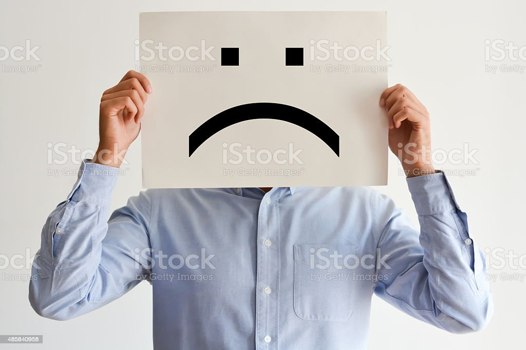 Unhappy employee or demotivated at working place stock photo