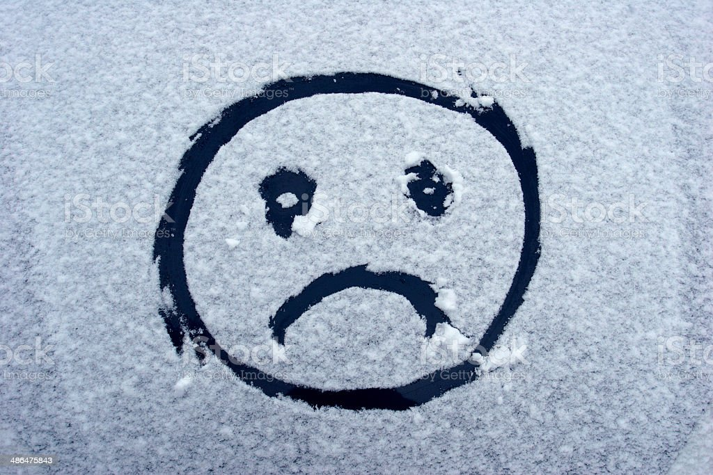 Unhappy face in winter snow royalty-free stock photo