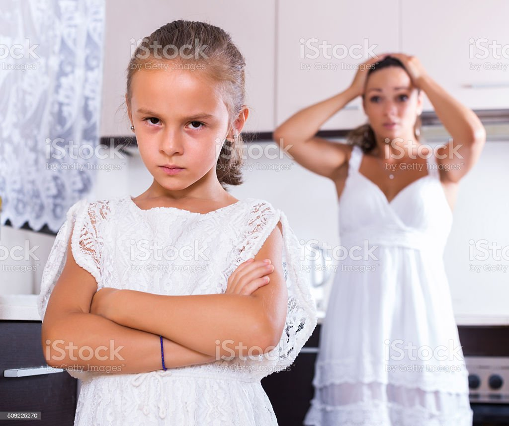 Unhappy girl and mother arguing stock photo