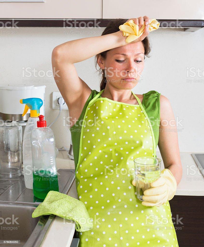 Unhappy girl do housework stock photo