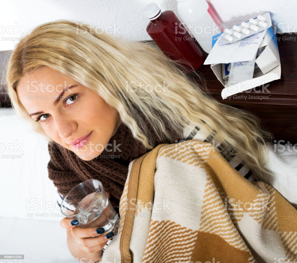Unhappy girl suffering of sore throat stock photo