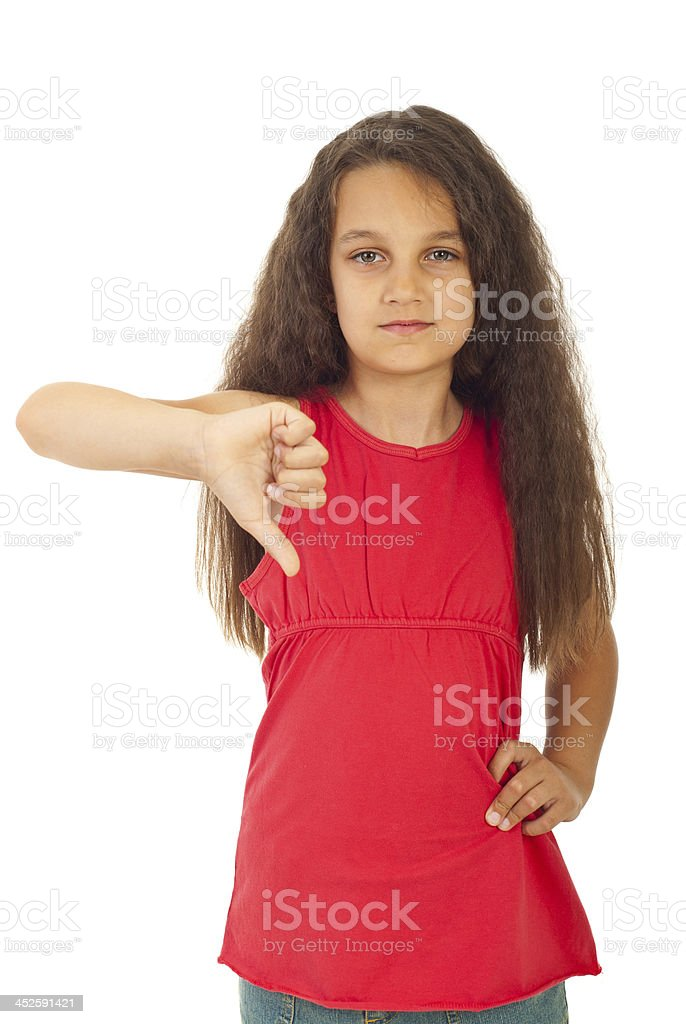 Unhappy girl with thumb down stock photo