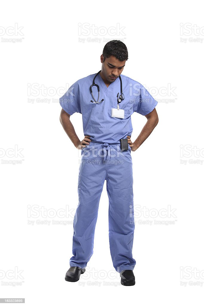 Unhappy healthcare worker in scrubs stock photo