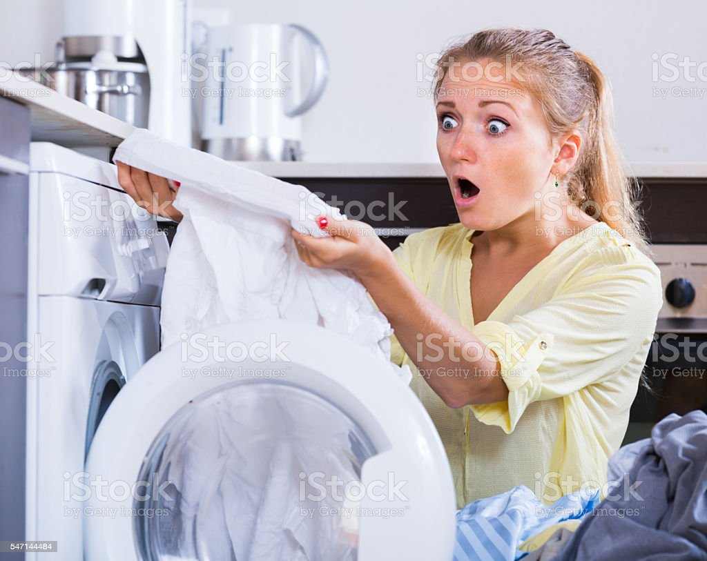 Unhappy housewife looking dirty spot stock photo