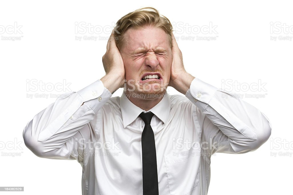 Unhappy Irritated Man Covering Ears royalty-free stock photo