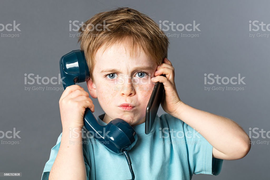 unhappy kid listening to two voices for burnout communication concept stock photo
