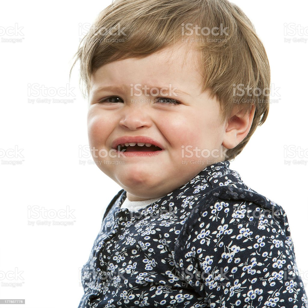 Unhappy little girl crying. stock photo