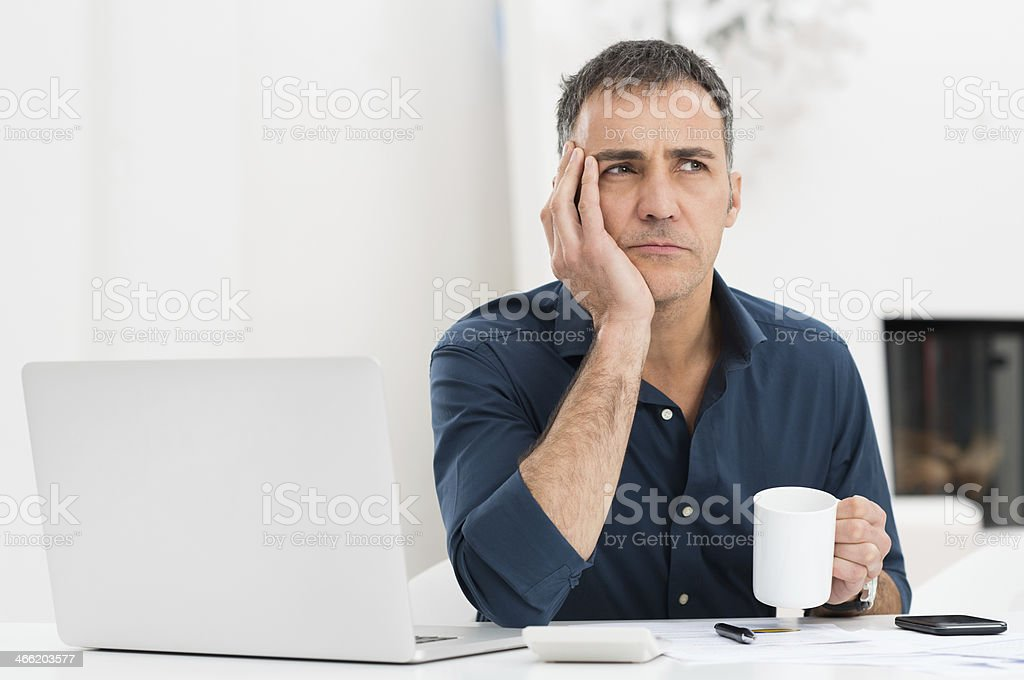 Unhappy Man At The Desk stock photo