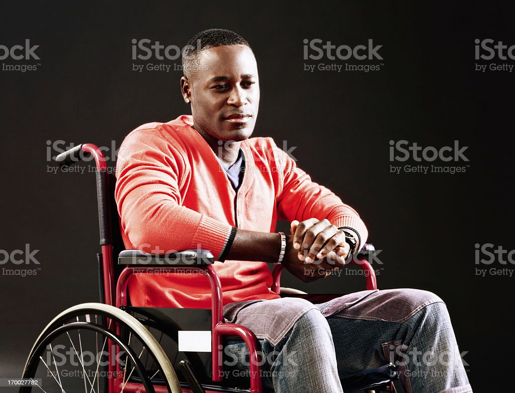 Unhappy man in wheelchair, possibly an injured athlete royalty-free stock photo