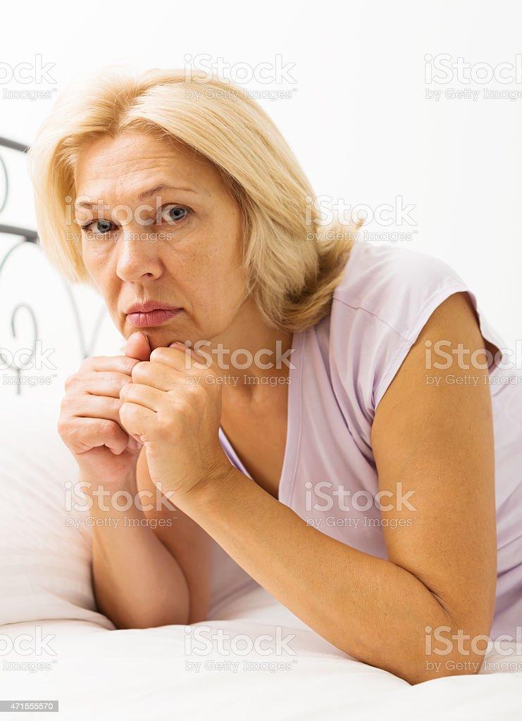 unhappy mature woman stock photo