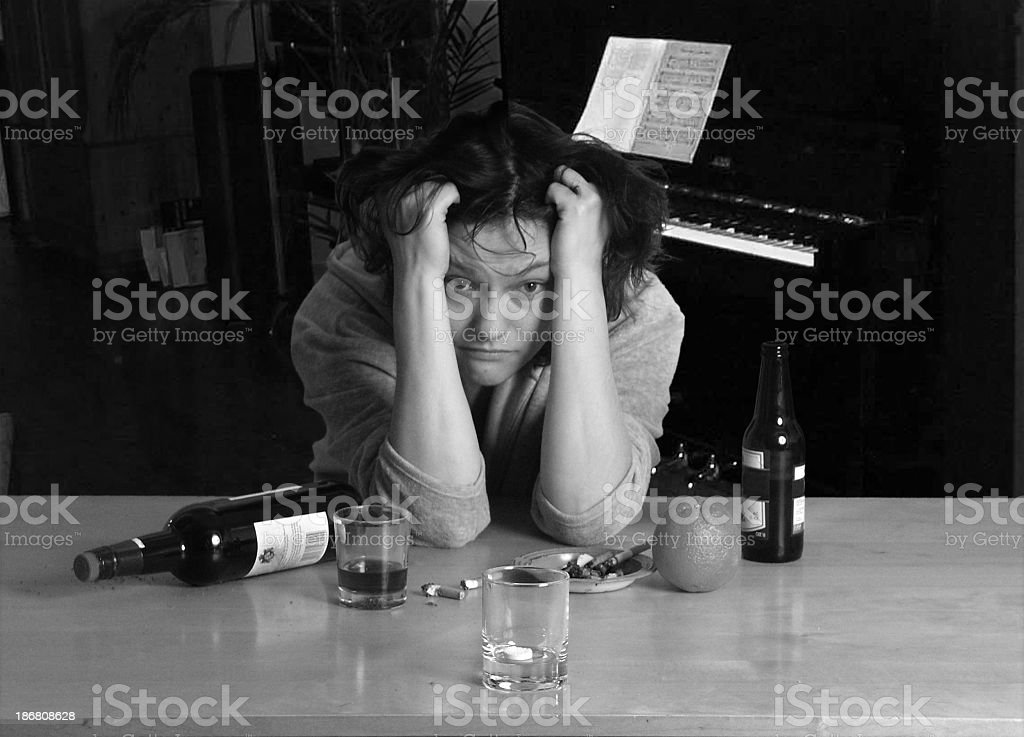 Unhappy sad hangover woman with anticid and bottles royalty-free stock photo