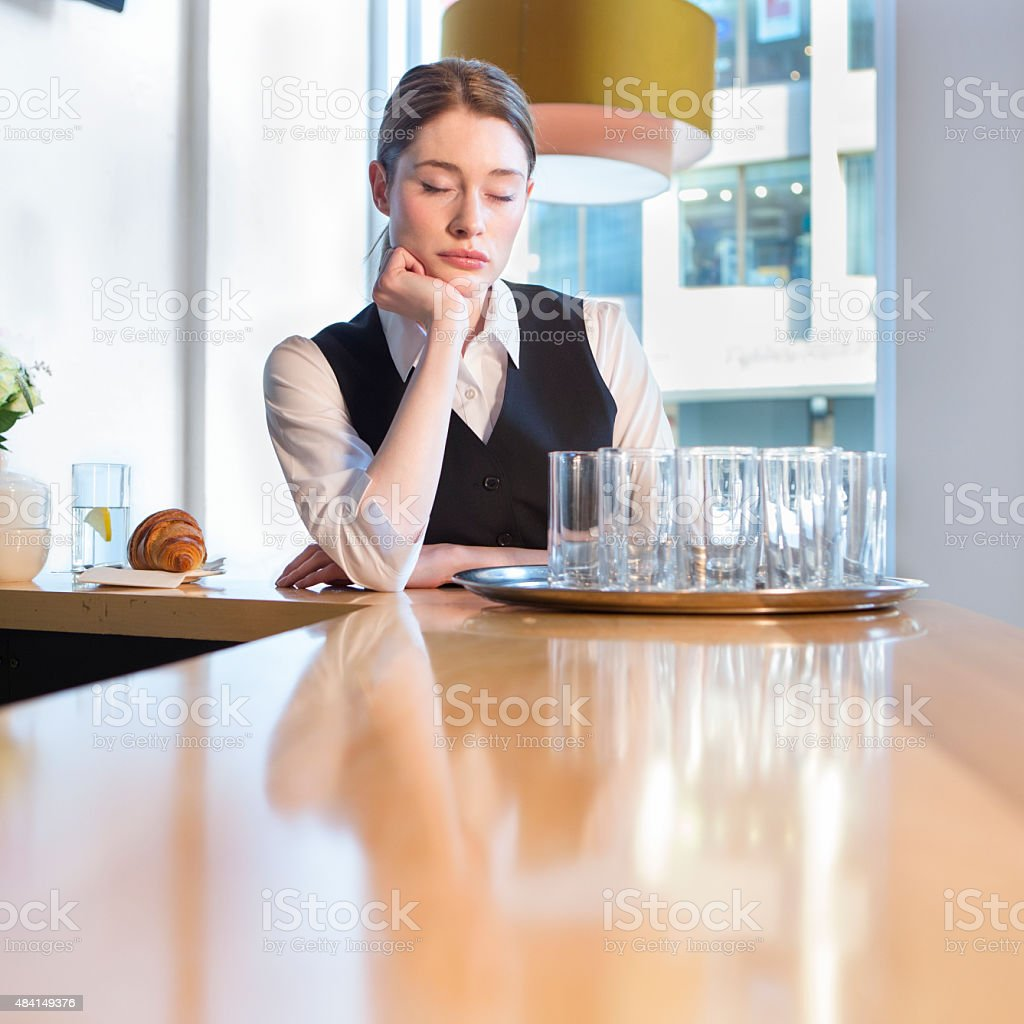Unhappy waitress at work stock photo