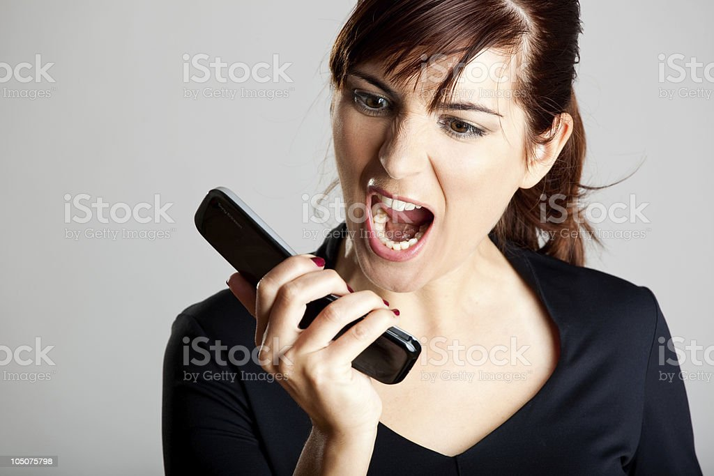 Unhappy woman at cellphone royalty-free stock photo