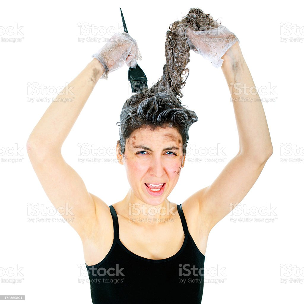 Unhappy Woman dyeing hairs royalty-free stock photo