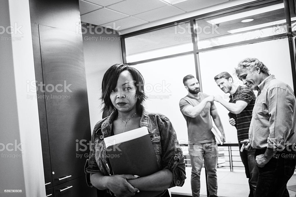 Unhappy Woman Feeling Sexually Harassed in the Office stock photo