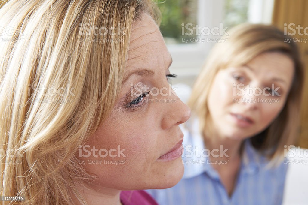 Unhappy Woman In Conversation With Friend Or Counsellor royalty-free stock photo