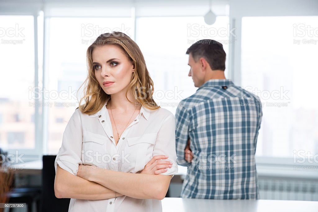 Unhappy woman in quarrel with her husband at home stock photo