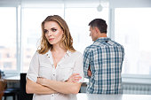 Unhappy woman in quarrel with her husband at home