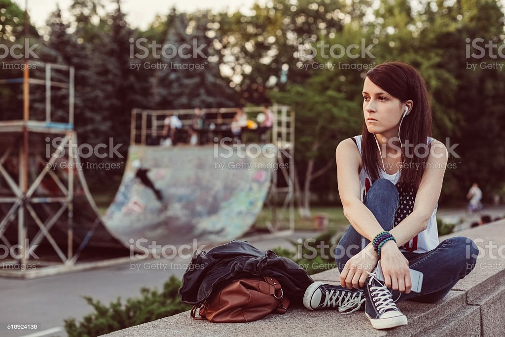 Unhappy woman listening to the music stock photo