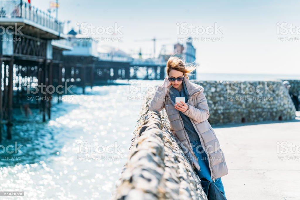 Unhappy woman texting stock photo