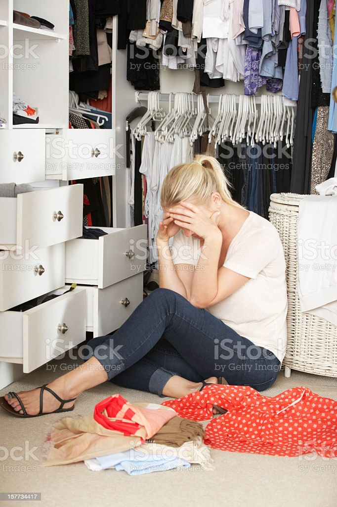 Unhappy Women Unable To Find Suitable Outfit In Wardrobe royalty-free stock photo