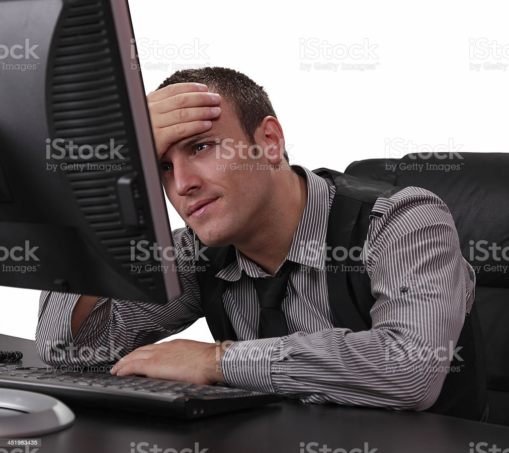 Unhappy Young Man in Front of the Computer stock photo