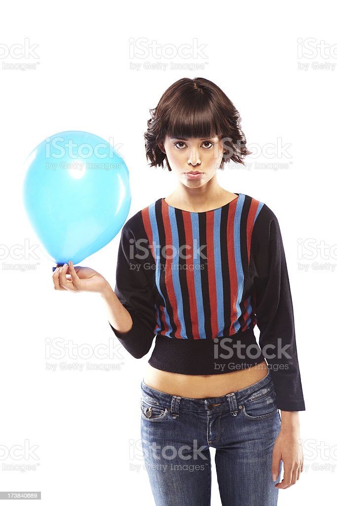 Unhappy Young Woman Holding a Blue Balloon. Isolated. stock photo