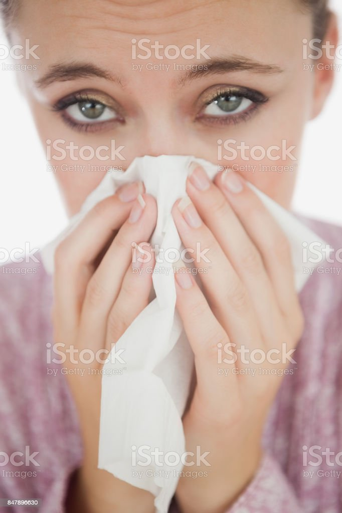 Unhappy young woman suffering from cold stock photo