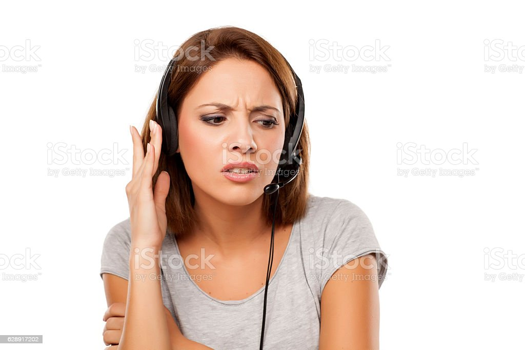 unhappy young woman with headset on her head stock photo