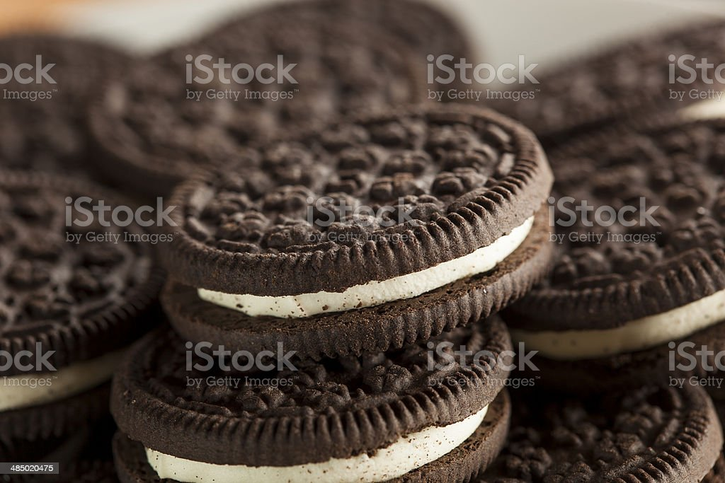 Unhealthy Chocolate Cookies with Cream Filling stock photo