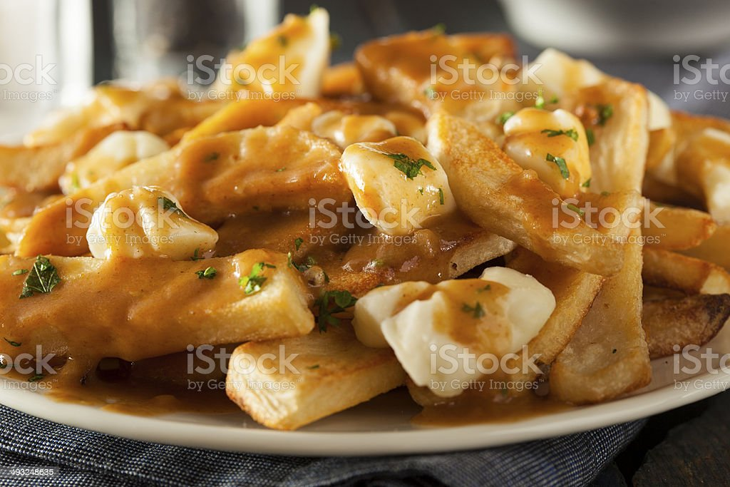 Unhealthy Delicious Poutine with French Fries stock photo
