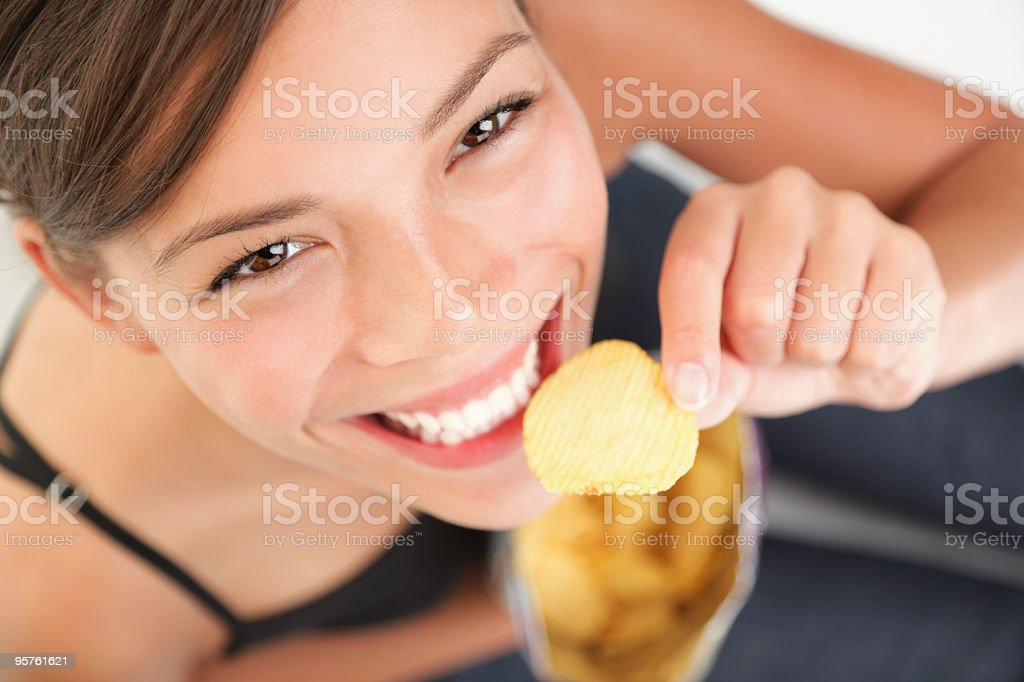 Unhealthy eating woman stock photo