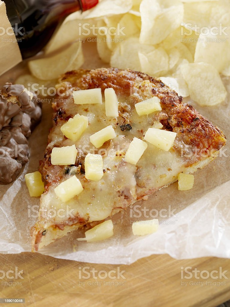 UnHealthy Packed Lunch with Leftover Ham And Pineapple Pizza royalty-free stock photo