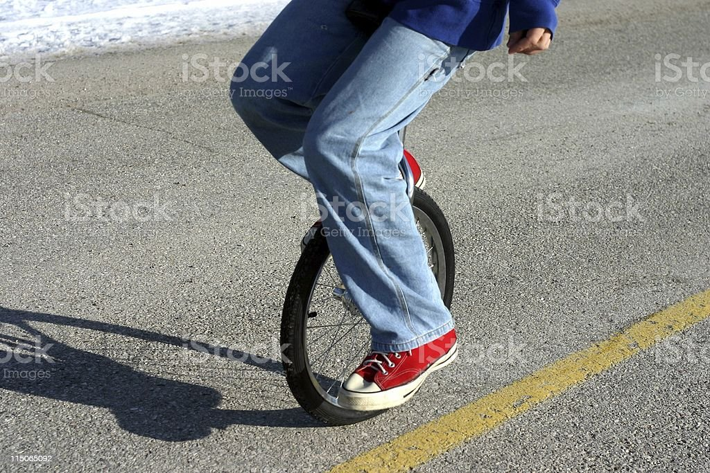 unicycle balance/ closeup royalty-free stock photo