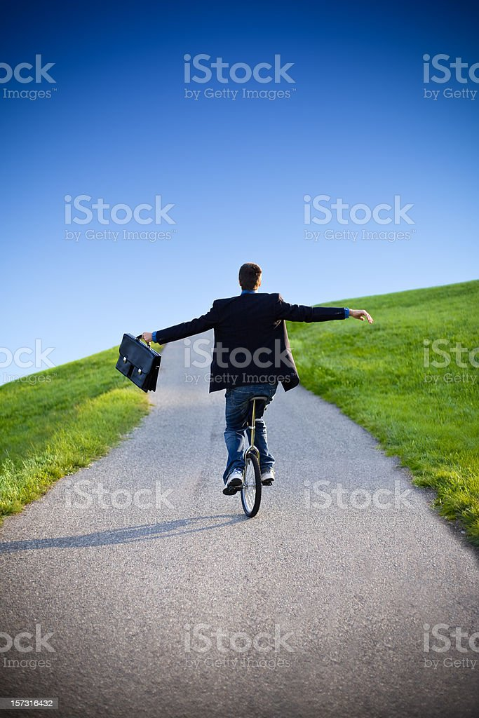 unicycle businessman outdoor balance stock photo